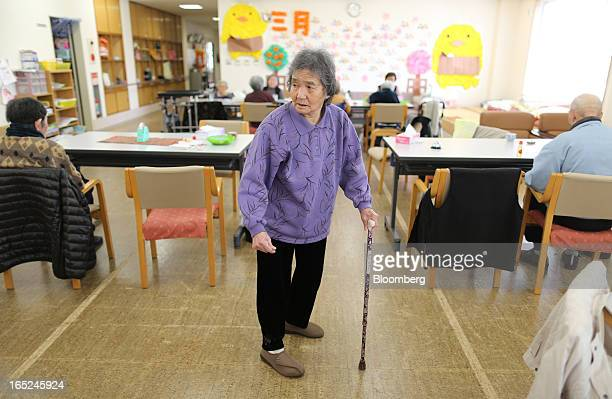 Yayoi Hamada uses a walking stick as she walks through a day care facility on Gogo Island in Matsuyama Ehime Prefecture Japan on Friday March 22 2013...