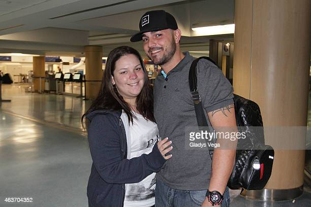 Yazaira Lopez and her husband Carlos Quinonez are sighted at Luis Munoz Marin Intl Airport on February 16 2015 in San Juan Puerto Rico