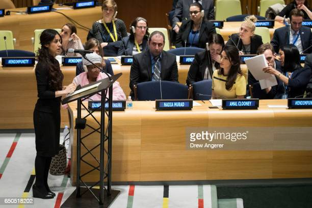 Yazidi human rights activist Nadia Murad speaks while Amal Clooney looks on during an event titled 'The Fight against Impunity for Atrocities...