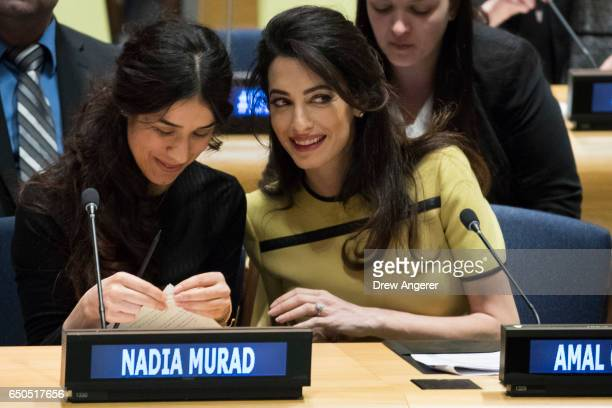 Yazidi human rights activist Nadia Murad speaks with Amal Clooney at an event titled 'The Fight against Impunity for Atrocities Bringing Da'esh to...