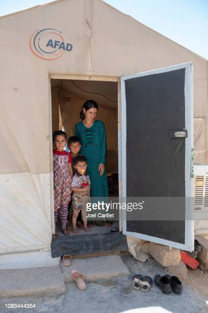 yazidi mother and children in idp camp - refugee camp stock pictures, royalty-free photos & images