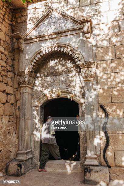 yazidi pilgrim entering lalish temple - dafos stock photos and pictures