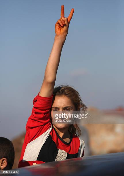 Yazidi refugee celebrates news of the liberation of her homeland of Sinjar from ISIL extremists while at a refugee camp on November 13 2015 in Derek...