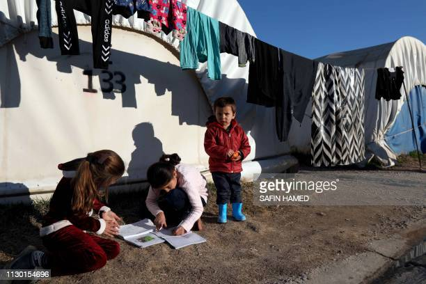 Yazidi refugee children play at the Kabarto camp for internally displaced persons some fifteen kilometres northwest from the Iraqi city of Dohuk on...