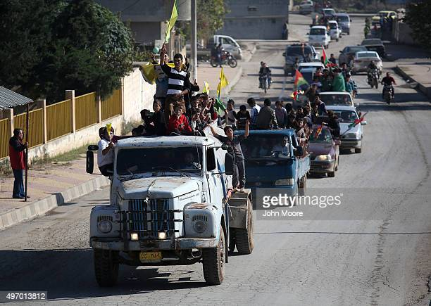Yazidi refugees celebrating news of the liberation of their homeland of Sinjar from ISIL extremists on November 13 2015 in Derek Rojava Syria Kurdish...
