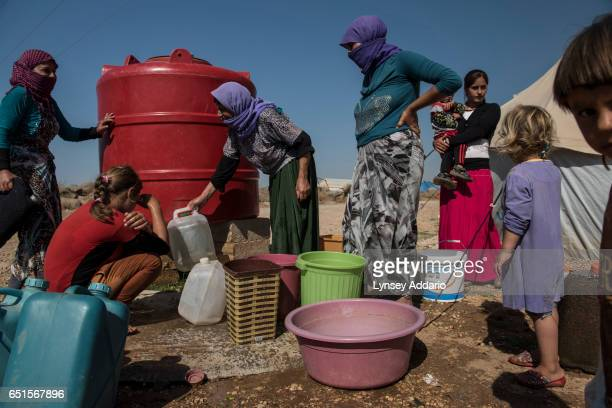 Yazidi refugees displaced roughly one year prior when fighters with the Islamic State attacked their villages around Sinjar Mountains live in the...