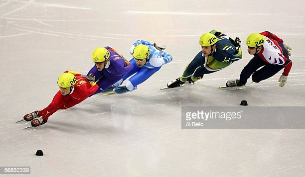 Ye Li of China Cees Juffermans of the NetherlandsFabio Carta of Italy Mark McNee of Australia and Mikhail Rajine of Russia skate in the third heat of...