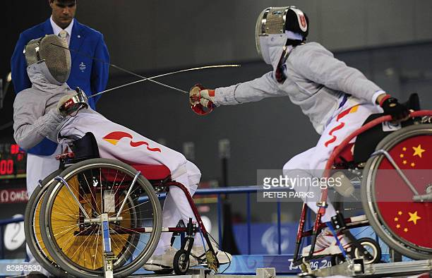 Ye Ruyi of China fights his compatriot Tian Jianquan in the men's Individual Sabre A final event during the 2008 Beijing Paralympic Games at the...