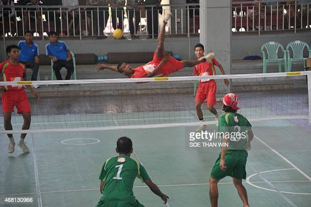 Ye Thura of the Ministry of Defence team kicks the ball against the 16/1 team during the 4TV Cup match at the Myanmar Sepak Takraw Federation's court...