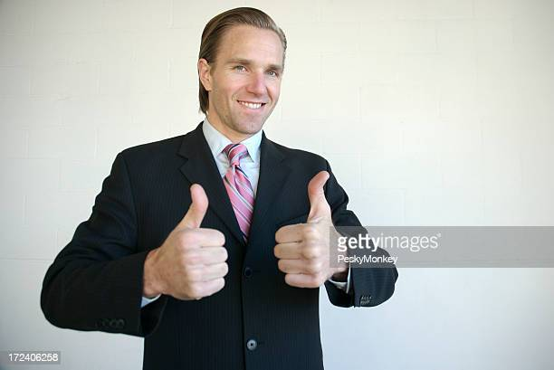Yeah Baby! Enthusiastic Businessman Giving Two Thumbs Up
