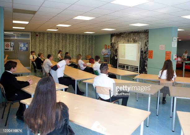 Year 10 pupils watch on as the head teacher gives a presentation. Ortu Gable Hall School in Corringham, Essex return after a long break due to the...
