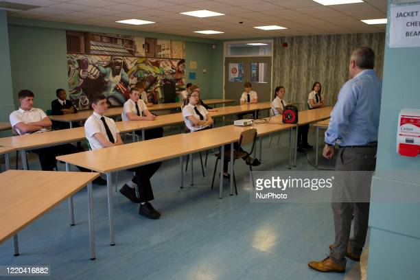 Year 10 pupils watch on as the head teacher gives a presentation . Ortu Gable Hall School in Corringham, Essex return after a long break due to the...