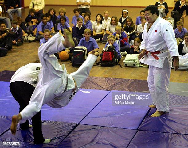 Year 10 student Kimberley Creek has a go at throwing one of the Judo team members as part of the Judo demonstration by a team from Newcastle's...