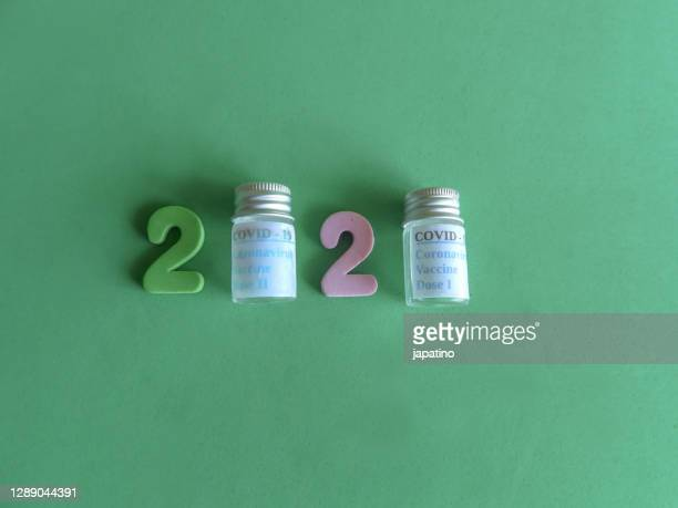 year 2020 and covid-19 - 2020 stock pictures, royalty-free photos & images