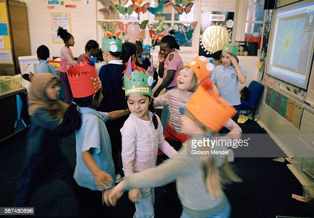 Year 3 children at Millfields Community School dance and frolick in their classroom during their end of term party This is a large innercity primary...