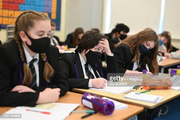 Year 6 students take a class at Park Lane Academy in Halifax, northwest England on March 17, 2021.