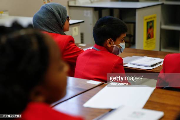 Year 7 students listen to a teacher in.a classroom at City of London Academy Highgate Hill on September 4, 2020 in London, England. A limited number...