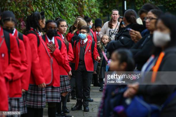Year 7 students practice social distancing measures and they wait to enter their school at City of London Academy Highgate Hill on September 4, 2020...