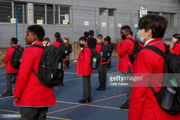 Year 7 students practice social distancing measures at City of London Academy Highgate Hill on September 4, 2020 in London, England. A limited number...