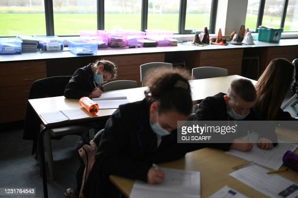 Year 7 students take a class at Park Lane Academy in Halifax, northwest England on March 17, 2021.