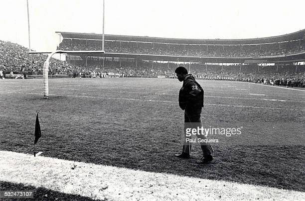 Year after suffering a debilitating knee injury, football player Gale Sayers, a running back for the Chicago Bears, walks in the endzone at half time...