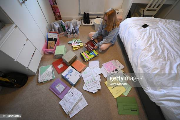 Year eleven student Tilly Mason ponders over her school books and revision materials after an unexpectedly premature end to her school year due to...