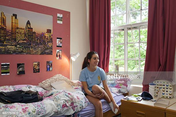 A year four pupil at Wellington College on the bed in her dormitory Wellington College is a British coeducational boarding and day independent school...