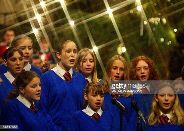 Year nine girls from Soham Village college sing a christmas carol 19 December 2002 at Ely Cathedral Cambridgeshire in memory of Holly Wells and...