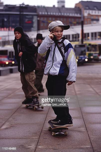 Year of Nokia in Finland on March 28 1999 Skate Boarding kid with Cell Phone