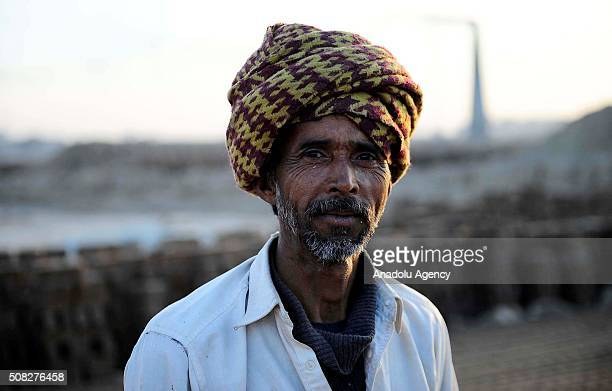 Year old Acmal from Bahawalpur city, who left his home to work at a brick kiln for 5 dollars daily wage to contribute his family, in Islamabad,...