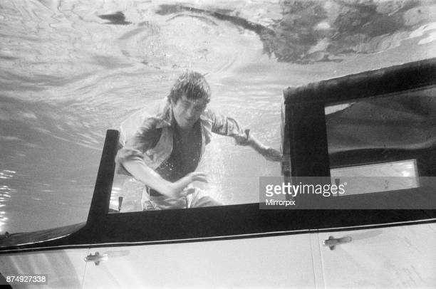 27 year old actor Michael Crawford who doesn't use stunt men in dangerous parts filming underwater with a Rolls Royce at MGM Studios Elstree for the...