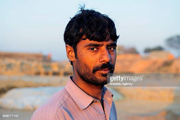 Year old Adnan Mohammad from Sialkot city, who left his home to work at a brick kiln for 5 dollars daily wage to contribute his family, in Islamabad,...