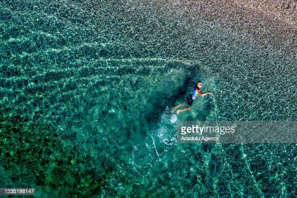 """Year old Ali Bidi, also known as """"Iron Man"""" swims in the sea as he trains and aims to become world champion in triathlon in Turkey's Antalya province..."""