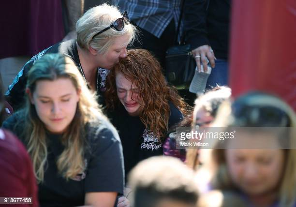 16 year old Alyssa Kramer gets a hug from her mother Tonja Kramer during a prayer vigil for famlies of Marjory Stoneman Douglas High School where a...