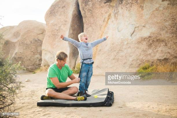 7 year old and dad high desert bouldering - chalk bag stock pictures, royalty-free photos & images