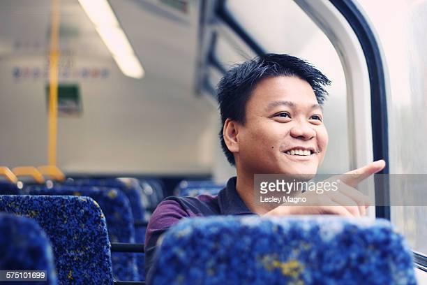 30-35 year old Asian-Filipino man at Sydney train