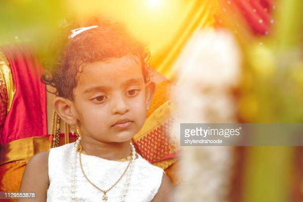 3 year old  baby girl standing in the crowd - diya oil lamp stock pictures, royalty-free photos & images