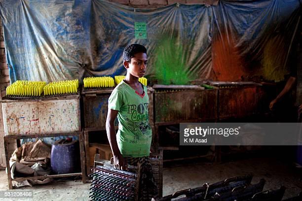 A 12 year old Bangladeshi boy works in a balloon factory at Kamrangir Char in Dhaka Bangladesh April 29 2014 In Bangladesh at least 74 million...