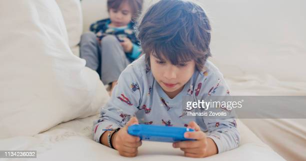 7 year old boy and his brother playing video game