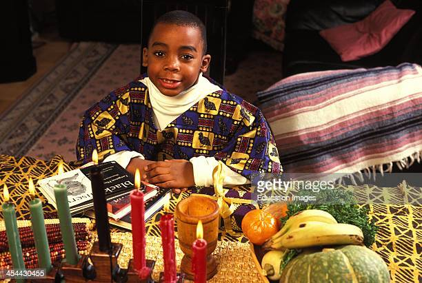 6 Year Old Boy At Kwanzaa With Candles In Foreground