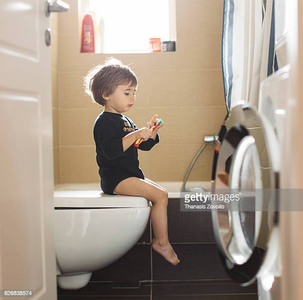1 year old boy brushing teeth