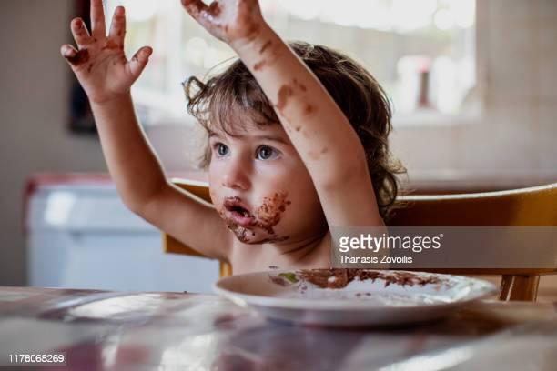 2 year old boy eating breakfast - 嫌悪感 ストックフォトと画像