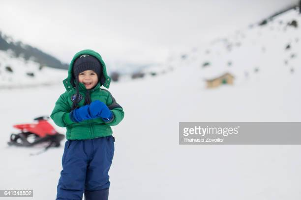 2 year old boy enjoy snow