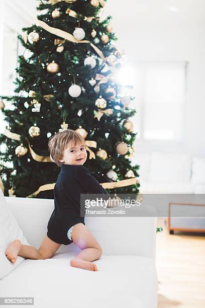 5 year old boy in front of a christmas tree
