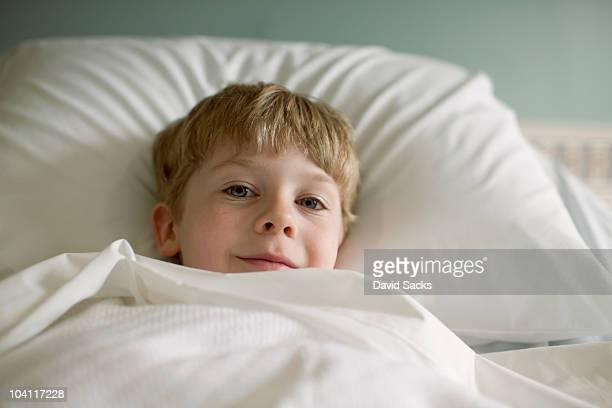 6 year old boy lying in bed