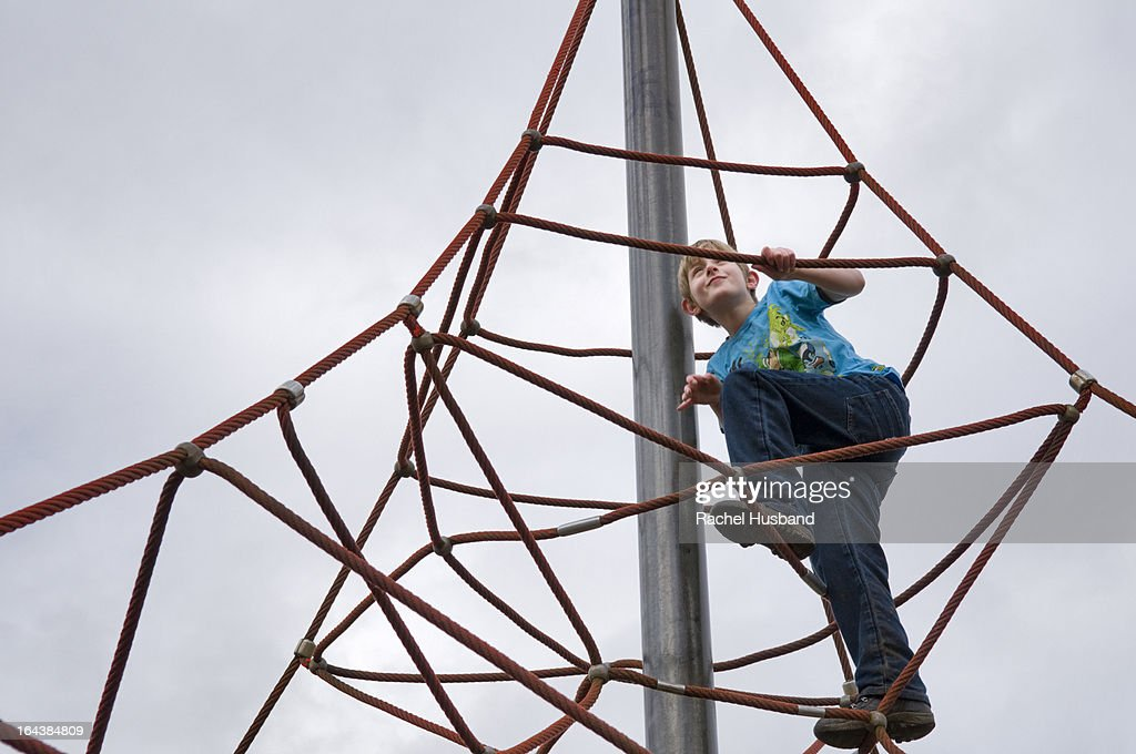 10 Year Old Boy On Rope Climbing Frame Stock Photo | Getty Images