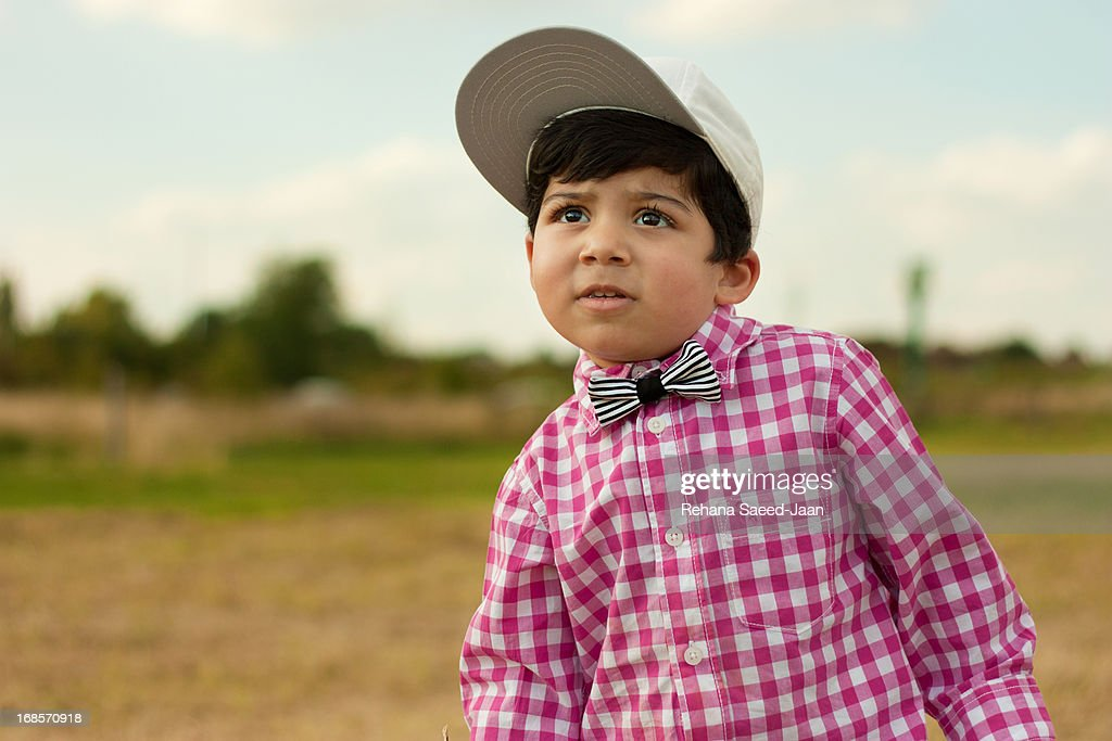 Portrait Of 2 Year Old Boy In Garden High-Res Stock Photo