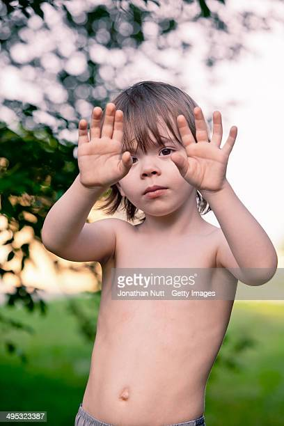 3 1/2 year old boy playing alone outside