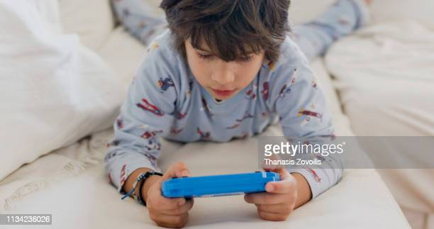 7 year old boy playing video game