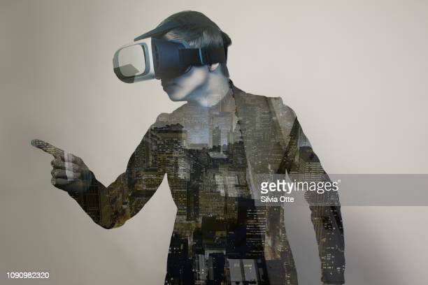 15 year old boy playing video game wearing virtual reality glasses